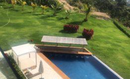 Departamento en Venta- Costa Marques Acapulco- Vista aerea alberca y areas verdes